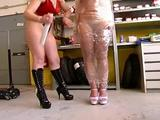 Hot mistress teasing a slave girl